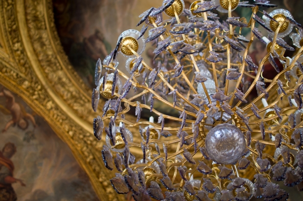 This is a chandelier inside the Palais de Versailles. This palace is where all the kings and queens of France lived.